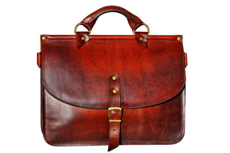 Business stylish strict leather briefcase in red-brown color with a belt buckle in the middle in vintage style isolated on white background. Stock Photo