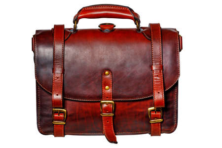 Leather red-brown briefcase with narrow straps and brass buckles in vintage style isolated on white background.