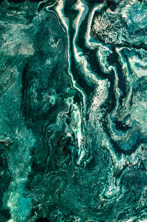Marble texture of the polished surface with stripes, wavy streaks, malachite emerald shade. Vertical image, copy space.