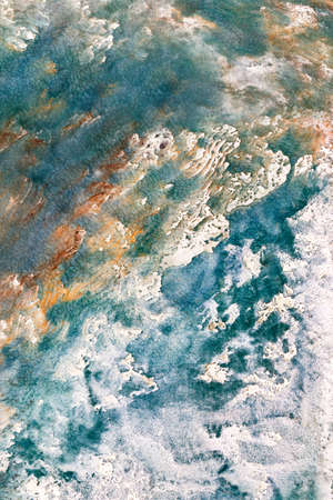 Sea surf with diagonal waves on an abstract plaster textured drawing in interior design. Vertical image. 免版税图像