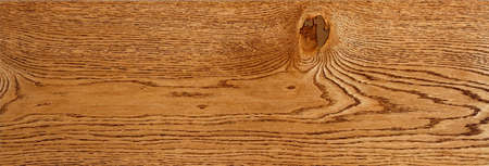 Beautiful pattern of oak wood planks in the form of a smooth wooden surface with horizontal lines of fibers, panoramic image for a banner.