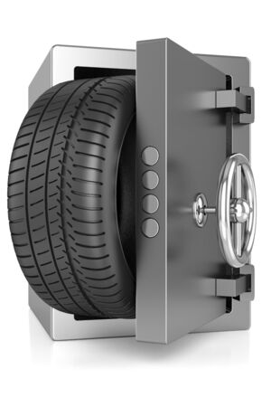 office theft: metal safe and a car tire isolated on white background Stock Photo