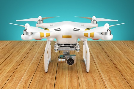 plan éloigné: White Quadcopter drone with a video camera on a wooden table 3d