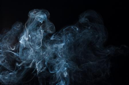 moving smoke on a black background Stock Photo