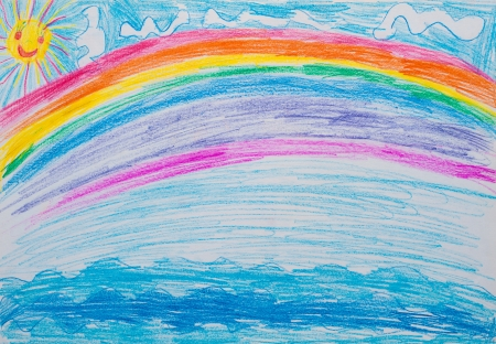 Children s drawing rainbow on sea photo