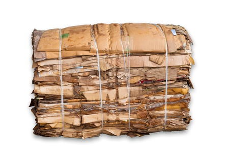 dump yard: bale of cardboard isolated on white