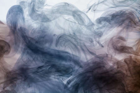 Abstract smoke moves on a white background photo