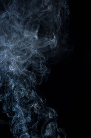Abstract smoke moves on a black background photo
