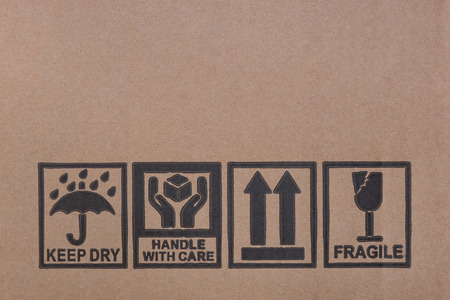 packaging symbols on cardboard closeup photo