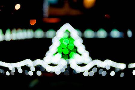 Blurred christmas tree lights on black background photo