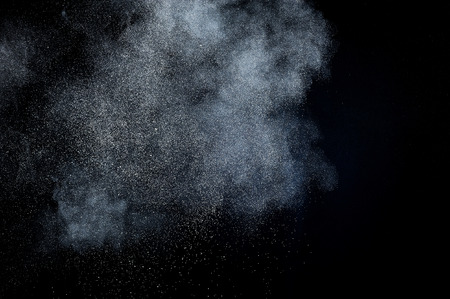 background waterfalls: abstract white powder explosion  on black background