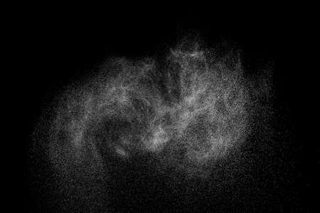 splash abstract: abstract splashes of milk on a black background