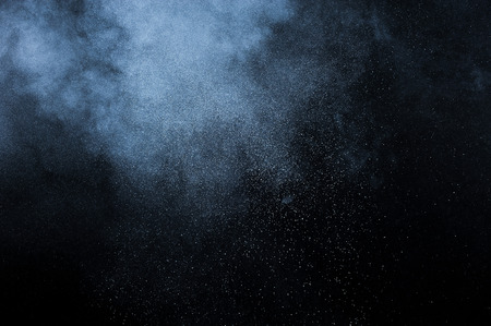 abstract white powder explosion  on black background