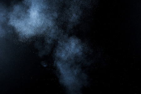 explosion: abstract white powder explosion  on black background