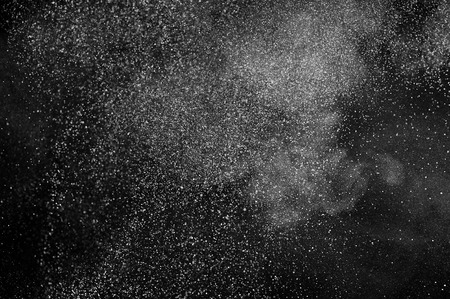 abstract white dust explosion  on a black background. abstract white powder explosion  on a black background. Foto de archivo