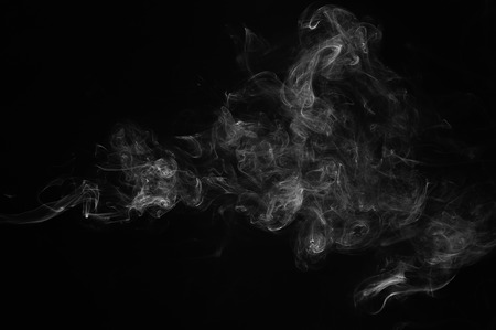 black smoke: Abstract smoke moves on a black background. Design element. Abstract texture. Stock Photo