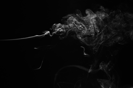 Abstract smoke moves on a black background. Design element. Abstract texture. Stock Photo