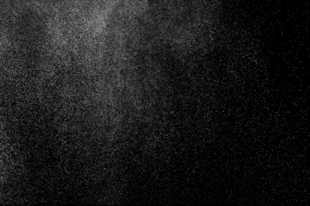 abstract splashes of water on a black background. splashes of milk. abstract spray of water. abstract rain. shower water drops.  white dust explosion. abstract texture. abstract black background.