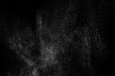 cloudburst: abstract splashes of water on a black background. splashes of milk. abstract spray of water. abstract rain. shower water drops.  white dust explosion. abstract texture. abstract black background.