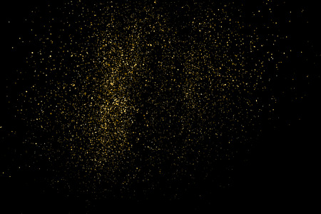 Gold glitter texture on a black background. Holiday background. Golden explosion of confetti. Golden grainy abstract  texture on a black  background. Design element. 矢量图像