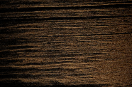 Sandy wave isolated on black background. Abstract sand dune.