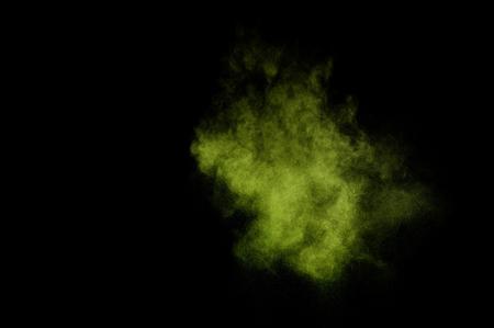 green powder: Light green powder explosion on black background.
