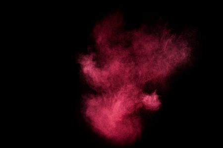 pink powder: Red and pink powder explosion on black background. Stock Photo