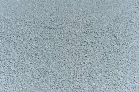 roughcast: Gray plaster close up. Abstract wall texture. Design element. Background rough.