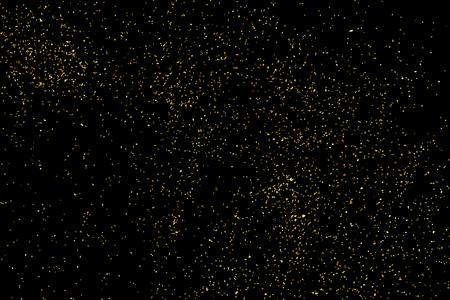 celebratory: Gold glitter texture isolated on black. Celebratory background. Golden explosion of confetti.
