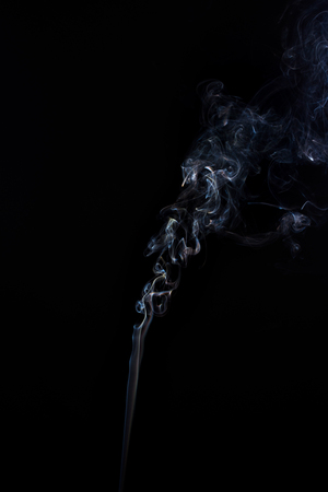 Freeze motion of smoke on black background.  Abstract vape clouds.