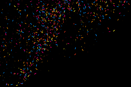 Colorful explosion of confetti. Grainy abstract  multicolored texture isolated on black background. Flat design element. Vector illustration,eps 10.