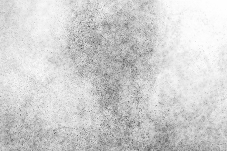 flux: Black particles explosion isolated on white background.  Abstract dust overlay texture. Stock Photo