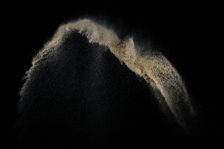 suelo arenoso: Sandy explosion isolated on black background. Abstract particles cloud. Texture element for design. Foto de archivo