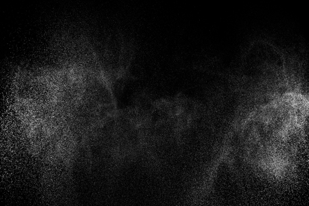 Abstract splashes of water on black background. Freeze motion of white particles. Rain, snow overlay texture.