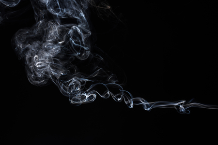 Smoke on black background.  Abstract vape clouds. Freeze motion.