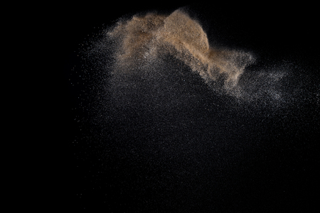gritty: Sandy explosion isolated on black background. Abstract particles cloud. Texture element for design. Stock Photo