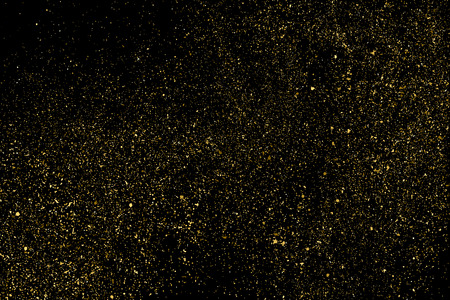 Gold glitter texture isolated on black. Amber particles color. Celebratory background. Golden explosion of confetti. Bitmap design elements. Raster copy.