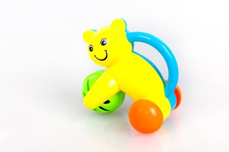 sound bite: Colorful rattle in the form of a cat with a ball on a white background, Baby Call toy, kids early development Stock Photo