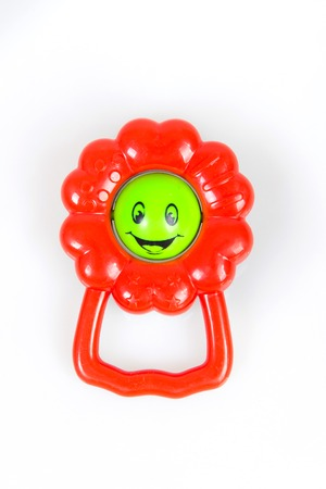 sound bite: Beautiful rattle in the form of a flower on a white background smiley, sonorous toys for children,