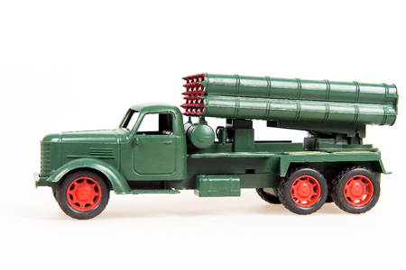 green military miniature: Toy military truck on a white background, a miniature model of the system Grad