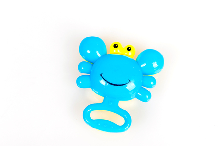 sound bite: Colorful rattle in the form of a crab on a white background, toys for children, voiced toy