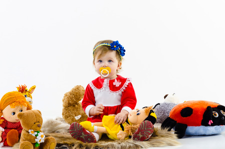 baby toys: The child, a little girl playing with soft toys, education and development of children, carefree childhood
