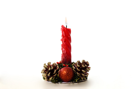 fir cones: Christmas candle in a candlestick with fir cones