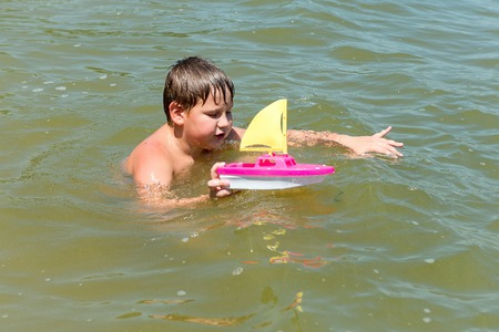 upbringing: Boy and girl, brother and sister playing in the water, summer vacation, carefree childhood, upbringing and development of children.