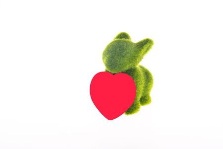 Green toy bunny with red heart