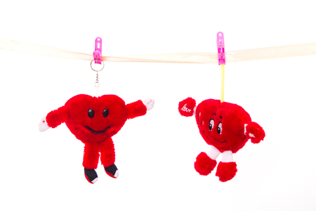 Soft toy strapped clothespins hanging heart on Valentines Day Stock Photo