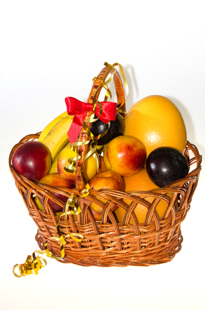Fresh fruits in a basket, vitamin picnic Stock Photo