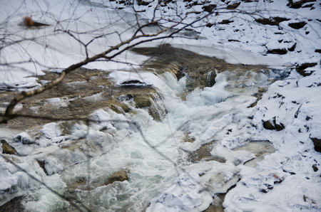 honing: Mountain river flowing rapidly Lamai ice and honing stones rocks. Stock Photo