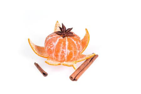 orange peel clove: Fresh juicy bright mandarin decorated with anise and vanilla sticks on a white background.