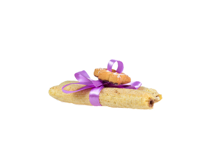 Tasty cookies knotted purple ribbon - a treat for a loved one. Stock Photo